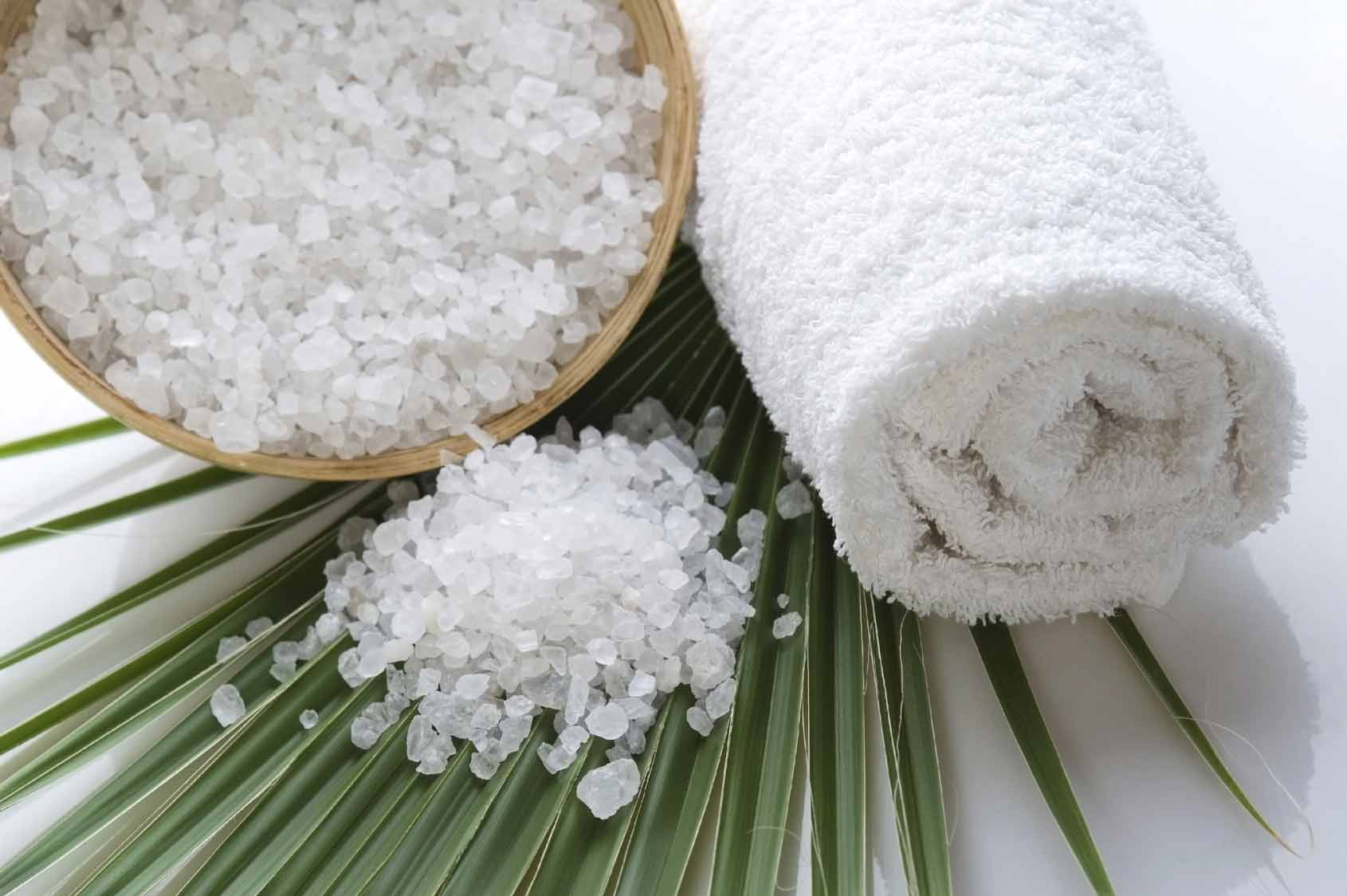 staged image of spa salt and towel at metta